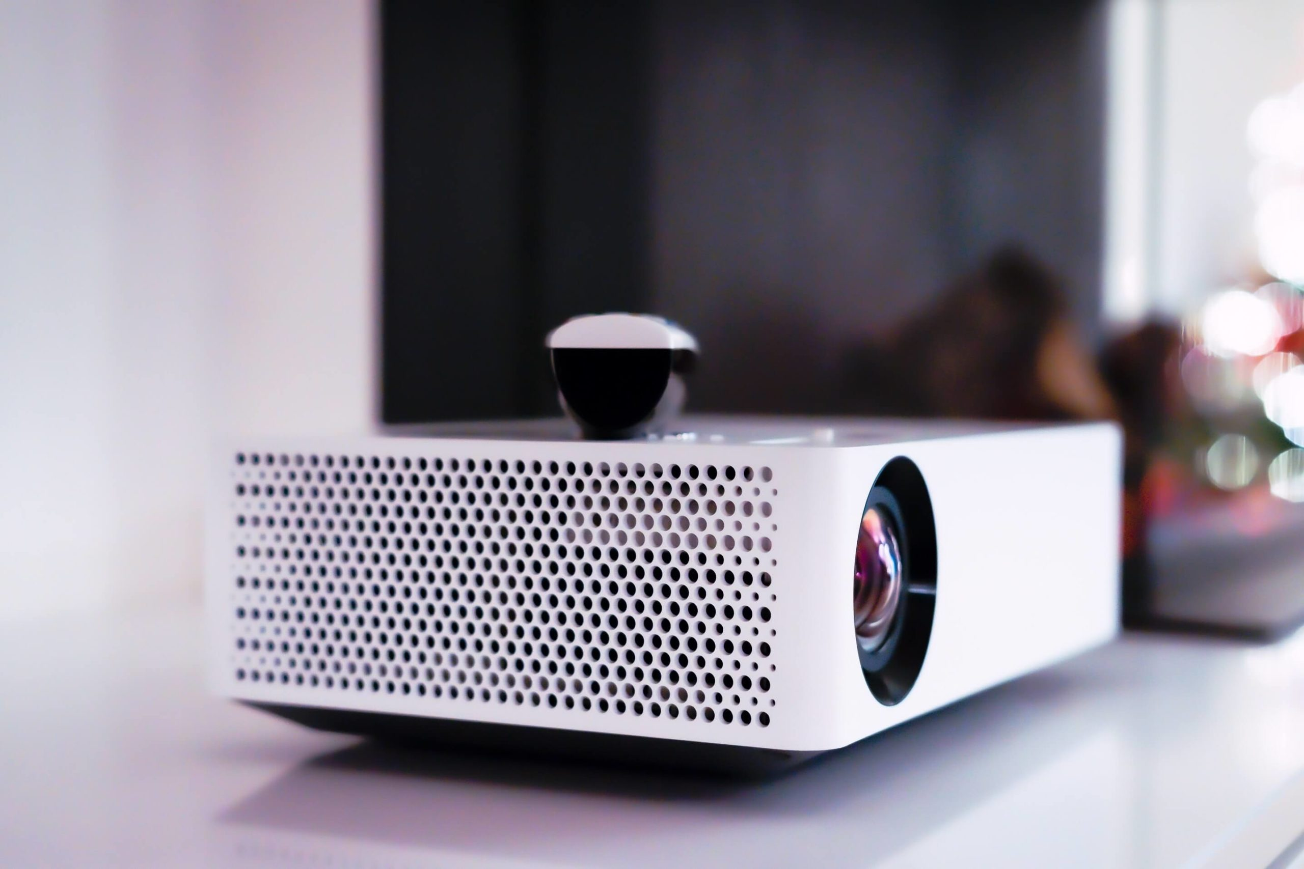 What should you consider while getting a home theater projector